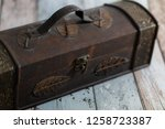 old chest on a wooden retro... | Shutterstock . vector #1258723387