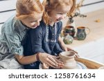 cheerful kids preparing a clay... | Shutterstock . vector #1258761634