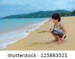 Cute Boy Playing On The Beach...