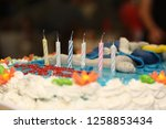 birthday cake with 6 candles | Shutterstock . vector #1258853434