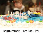 birthday cake with 6 candles | Shutterstock . vector #1258853491