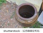 An Earthen Jar With Little...