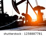 the oil workers at work | Shutterstock . vector #1258887781