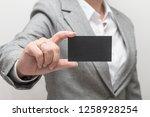 woman hand holding a business... | Shutterstock . vector #1258928254