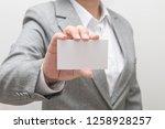 woman hand holding a business... | Shutterstock . vector #1258928257