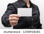 woman hand holding a business... | Shutterstock . vector #1258928281