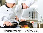 two chefs   man and woman   in... | Shutterstock . vector #125897957