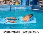 smiling european boy is... | Shutterstock . vector #1259015077