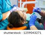 patient at dentist. dentist... | Shutterstock . vector #1259043271