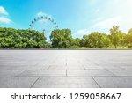 empty square floor and ferris... | Shutterstock . vector #1259058667