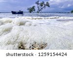the waves of the sea produce... | Shutterstock . vector #1259154424