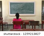 a young girl student looking at ... | Shutterstock . vector #1259213827