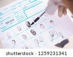 forensic expert studying... | Shutterstock . vector #1259231341