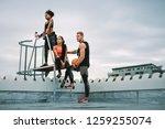 man holding a basketball... | Shutterstock . vector #1259255074