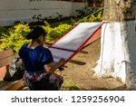 woman weaving in an old village ...   Shutterstock . vector #1259256904