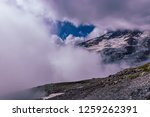 late afternoon clouds over high ... | Shutterstock . vector #1259262391