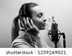 young beautiful girl records... | Shutterstock . vector #1259269021