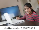pretty girl working with laptop ... | Shutterstock . vector #125928551