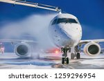 winter morning at airport.... | Shutterstock . vector #1259296954