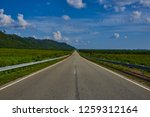 empty highway leading to the... | Shutterstock . vector #1259312164