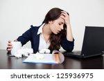 sick woman at work with headache | Shutterstock . vector #125936975