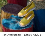 Stock photo espadrilles on colored stumps a pair of yellow espadrilles a pair of yellow espadrilles in nature 1259373271