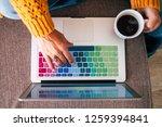 top view of woman hands working ... | Shutterstock . vector #1259394841
