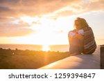 beautiful curly woman sitting... | Shutterstock . vector #1259394847