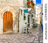 traditional narrow streets with ... | Shutterstock . vector #1259488351
