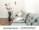 lovely young couple in a living ...   Shutterstock . vector #1259529967