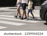 children crossing the street... | Shutterstock . vector #1259543224