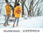 friends walking by snowed park...   Shutterstock . vector #1259594914
