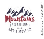 mountains are calling and i... | Shutterstock .eps vector #1259597011