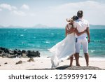 couple looking at the sea in... | Shutterstock . vector #1259599174