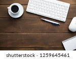 notepad with computer and cup...   Shutterstock . vector #1259645461