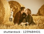 happy young family with two... | Shutterstock . vector #1259684431