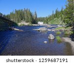 Small photo of View of Lewis River with Lewis Falls and the bridge at Yellowstone National Park, Wyoming, USA