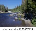 Small photo of Side shot of Lewis River with Lewis Falls at Yellowstone National Park, Wyoming, USA