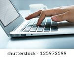 closeup of businessman typing... | Shutterstock . vector #125973599