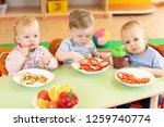 lunch in kindergarden. babies...   Shutterstock . vector #1259740774