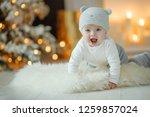 little baby at christmas    Shutterstock . vector #1259857024