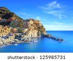 Manarola Village On Cliff Rock...