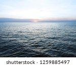 dark blue sea and light blue sky | Shutterstock . vector #1259885497
