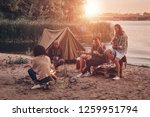 moments of joy. group of young... | Shutterstock . vector #1259951794