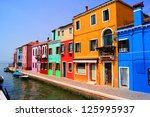 Colorful Houses Along A Canal...