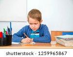 little student doing homework | Shutterstock . vector #1259965867