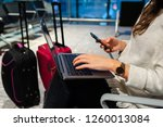 woman waiting his flight at... | Shutterstock . vector #1260013084