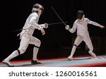 Two Man Fencing Athletes Fight...