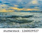 sea waves in a sea bay. golden... | Shutterstock . vector #1260029527