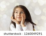 portrait of cute thoughtful... | Shutterstock . vector #1260049291